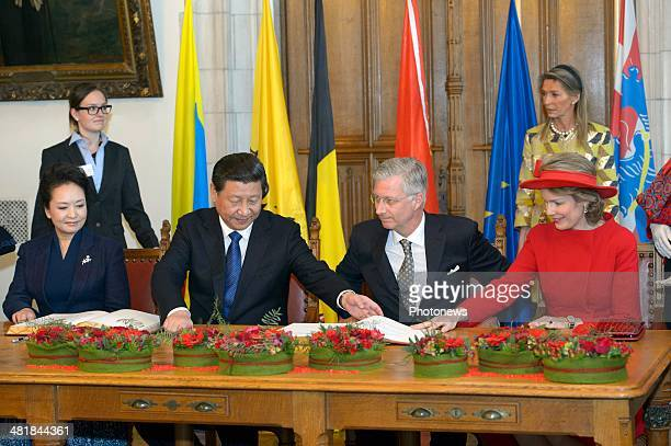 First Lady XiPeng Liyuan Chinese President Xi Jinping King Philippe and Queen Mathilde during a reception on April 1 2014 in Bruges Belgium