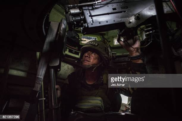 First Leutenant Geraldo Alvarez inside an armored personel carrier on July 21 2017 in Marawi southern Philippines 1st Leutenant Alvarez was in...