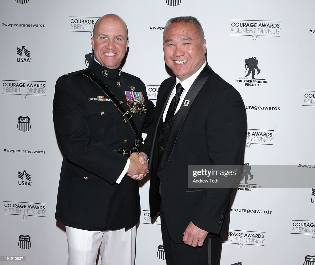 First lieutenant Dennis Oliverio (L) and George Sui attend the 9th annual Wounded Warrior Project Courage Awards & Benefit Dinner at The Waldorf=Astoria on May 29, 2014 in New York City.