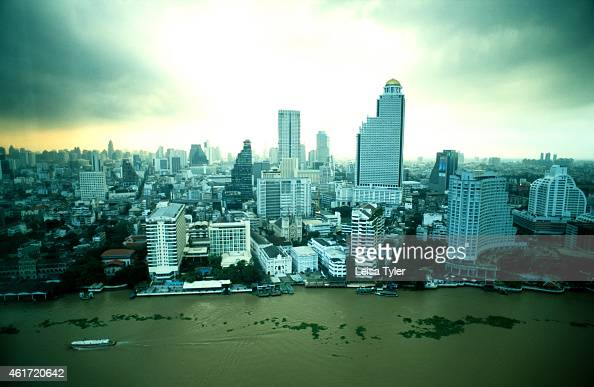 First light over the city of Bangkok and the Chao Phraya River from the top floor of the Peninsula Hotel in Klongsan A city of 12 million Bangkok is...