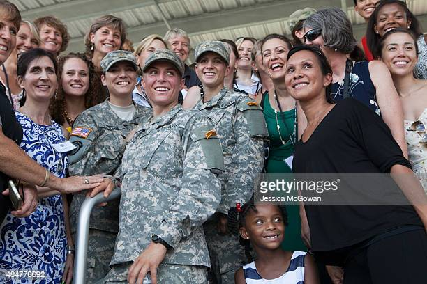 First Lt Shaye Haver and Capt Kristen Griest are surrounded by a group of female friends and supporters after receiving their Ranger tab and...