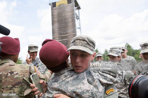 First Lt Shaye Haver gets a hug from a female soldier after receiving her Ranger tab during the graduation ceremony of the United States Army's...