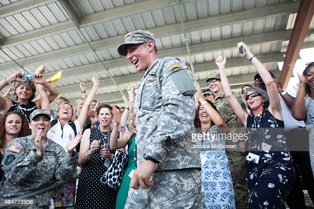 First Lt Shaye Haver is surrounded by a group of female friends and supporters after receiving her Ranger tab during the graduation ceremony of the...