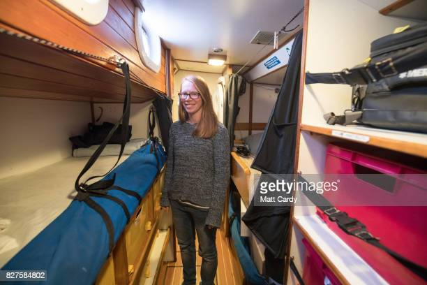 First mate Holly Vint from the allfemale eXXpedition crew poses for a photograph besides the bunks on board the yacht Sea Dragon as the crew prepare...
