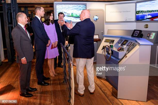 First Mayor of Hamburg Olaf Scholz and Museum director Peter Tamm give Prince William Duke of Cambridge and Catherine Duchess of Cambridge a tour of...