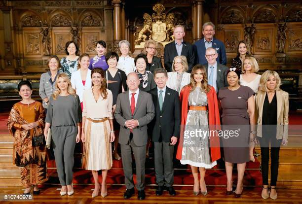 First Mayor of Hamburg Olaf Scholz poses with partners of Heads of State and Governments plus respresentatives of guest invitees during the partner...