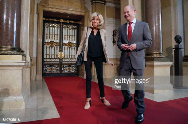 First Mayor of Hamburg Olaf Scholz welcomes Brigitte Macron wife of French President Emmanuel Macron during the partner program of G20 summit at the...