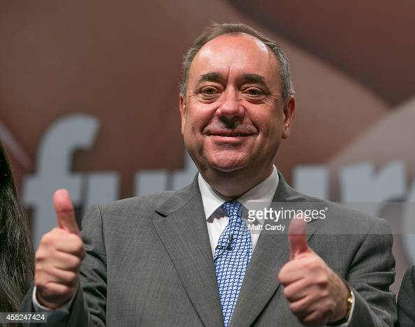 First Minister Alex Salmond gestures at the end of a press conference at the Edinburgh International Conference Centre on September 12 2014 in...