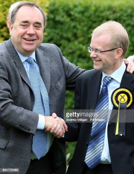 First Minister Alex Salmond shakes hands with SNP candidate for Glasgow East John Mason while visiting Garrowhill Bowling Club to highlight support...