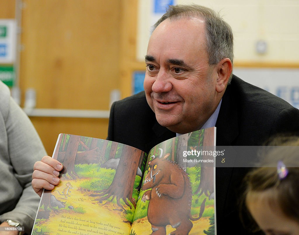 First Minister <a gi-track='captionPersonalityLinkClicked' href=/galleries/search?phrase=Alex+Salmond&family=editorial&specificpeople=857688 ng-click='$event.stopPropagation()'>Alex Salmond</a> talks to children during a visits to the North Edinburgh Childcare Centre to mark one year to go until the Scottish Independence Referendum on September 18th 2013 in Edinburgh, Scotland.