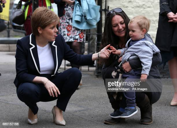 First Minister and SNP leader Nicola Sturgeon sticks out her tongue at twenty one month old Blair Layden with mum Mandy during a visit to Moffat on...