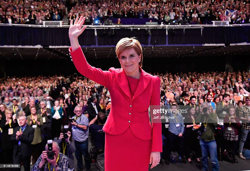 First Minister and SNP leader Nicola Sturgeon waves after she addressed the Scottish National Party Conference 2016 on October 15, 2016 in Glasgow, Scotland. Nicola Sturgeon ended her party's conference with a speech about a 'new political era' in the UK, stating that Scotland is 'open for business' in the post-Brexit era while also speaking about domestic policy priorities.