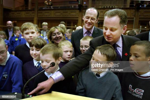 First minister Jack McConnell and Scottish National party leader John Swinney show school children from CooperAngus schoolTayside and Ardeer school...