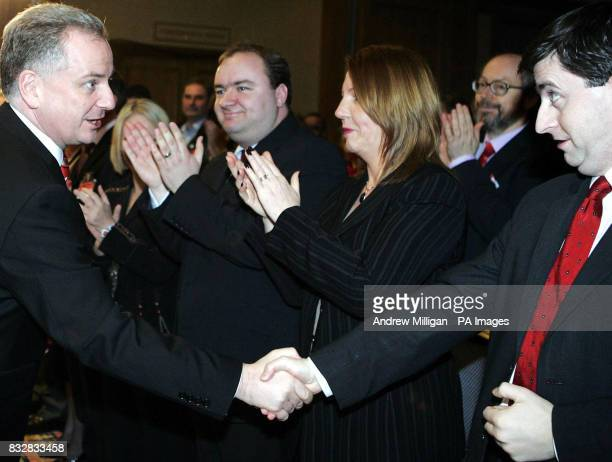 First Minister Jack McConnell shakes hands with Scotland Secretary Douglas Alexander after making a keynote speech during at a Labour one day seminar...