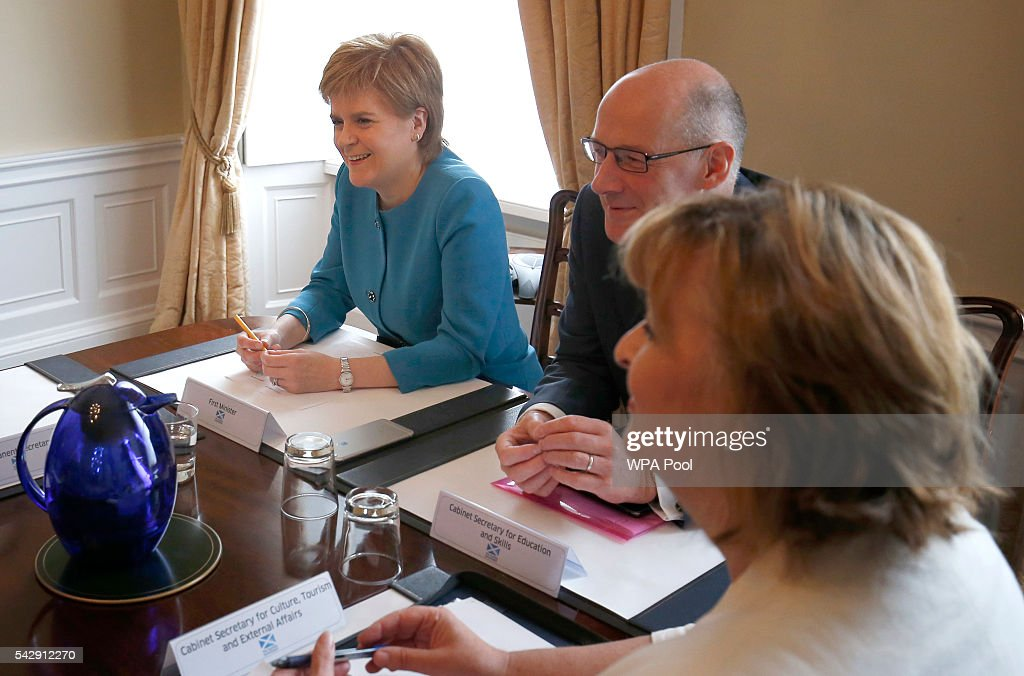 First Minister <a gi-track='captionPersonalityLinkClicked' href=/galleries/search?phrase=Nicola+Sturgeon&family=editorial&specificpeople=2582617 ng-click='$event.stopPropagation()'>Nicola Sturgeon</a> and and Deputy First Minister John Swinney attend an emergency cabinet meeting at Bute House on June 25, 2016 in Edinburgh. The government team gathered in Edinburgh to discuss the next steps they will take after the UK voted to leave the European Union by a margin of 52% to 48%.