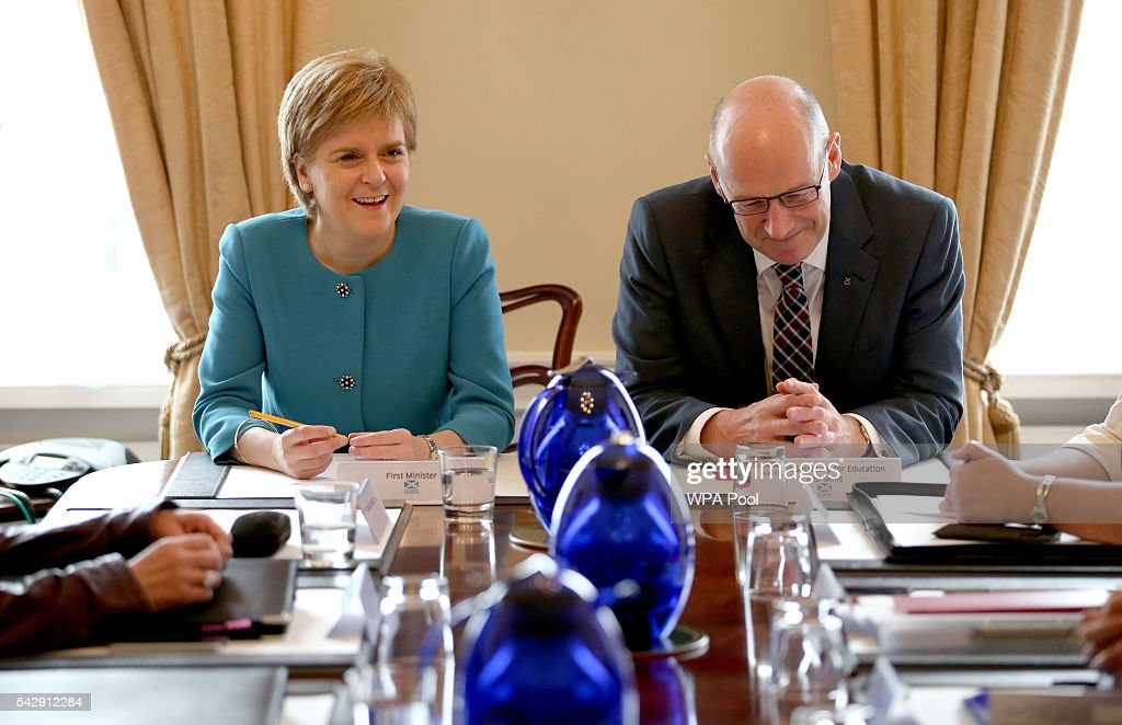 First Minister Nicola Sturgeon and and Deputy First Minister John Swinney attend an emergency cabinet meeting at Bute House on June 25, 2016 in Edinburgh. The government team gathered in Edinburgh to discuss the next steps they will take after the UK voted to leave the European Union by a margin of 52% to 48%.