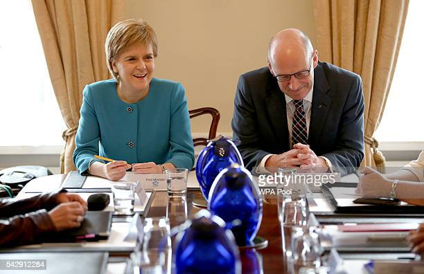 First Minister Nicola Sturgeon and and Deputy First Minister John Swinney attend an emergency cabinet meeting at Bute House on June 25 2016 in...