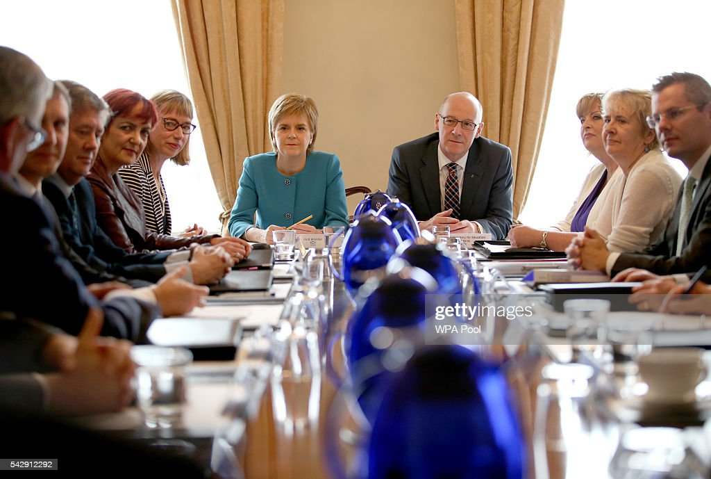 First Minister <a gi-track='captionPersonalityLinkClicked' href=/galleries/search?phrase=Nicola+Sturgeon&family=editorial&specificpeople=2582617 ng-click='$event.stopPropagation()'>Nicola Sturgeon</a> and and Deputy First Minister John Swinney (C, right) attend an emergency cabinet meeting at Bute House on June 25, 2016 in Edinburgh. The government team gathered in Edinburgh to discuss the next steps they will take after the UK voted to leave the European Union by a margin of 52% to 48%.
