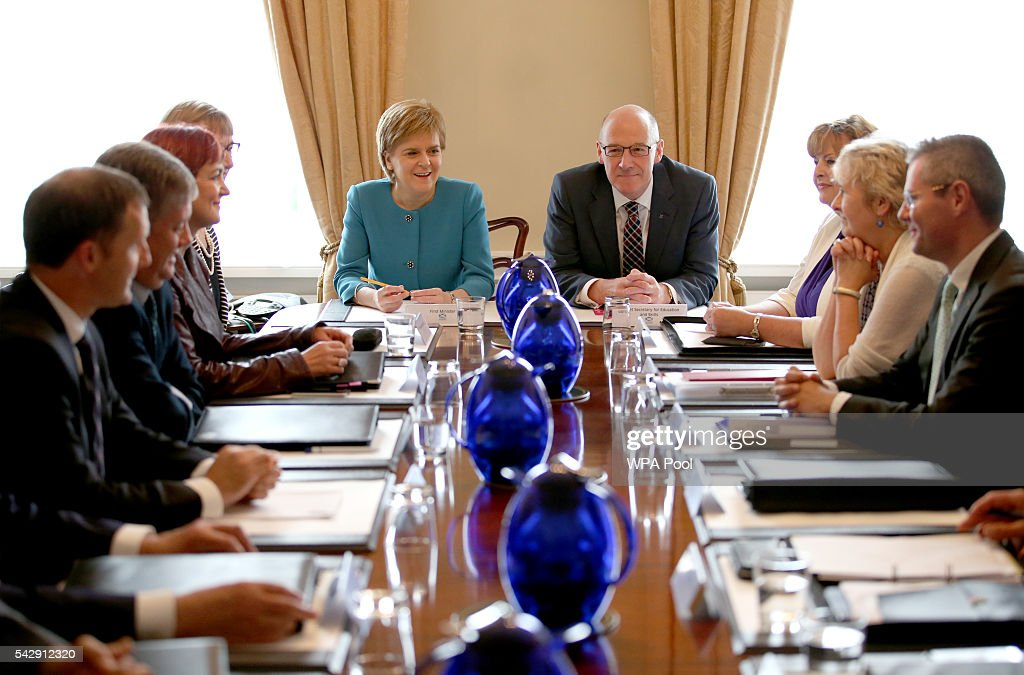 First Minister <a gi-track='captionPersonalityLinkClicked' href=/galleries/search?phrase=Nicola+Sturgeon&family=editorial&specificpeople=2582617 ng-click='$event.stopPropagation()'>Nicola Sturgeon</a> and Deputy First Minister John Swinney (C, right) attend an emergency cabinet meeting at Bute House on June 25, 2016 in Edinburgh. The government team gathered in Edinburgh to discuss the next steps they will take after the UK voted to leave the European Union by a margin of 52% to 48%.