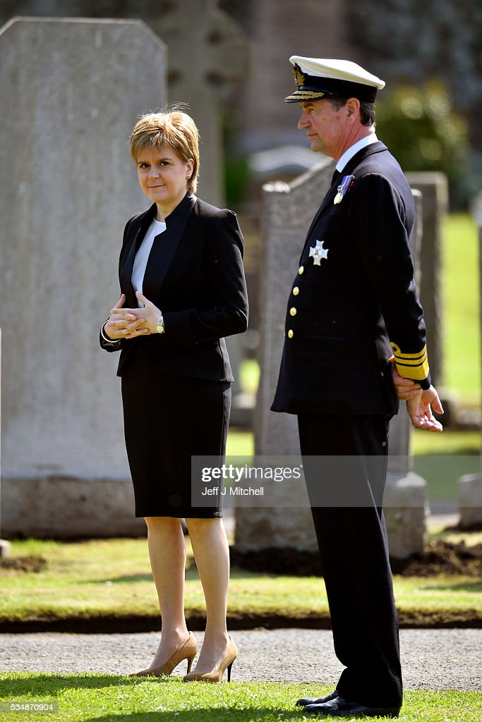 First Minister <a gi-track='captionPersonalityLinkClicked' href=/galleries/search?phrase=Nicola+Sturgeon&family=editorial&specificpeople=2582617 ng-click='$event.stopPropagation()'>Nicola Sturgeon</a> and Vice Admiral Sir Tim Laurence attend a service at a war graves cemetery to mark the Battle of Jutland on May 28, 2016 in South Queensferry, Scotland. The events begin a weekend of commemoration leading up to the anniversary on 31 May and 1 June to mark the centenary of the largest naval battle of World War One where more than 6,000 Britons and 2,500 Germans died in the Battle of Jutland.