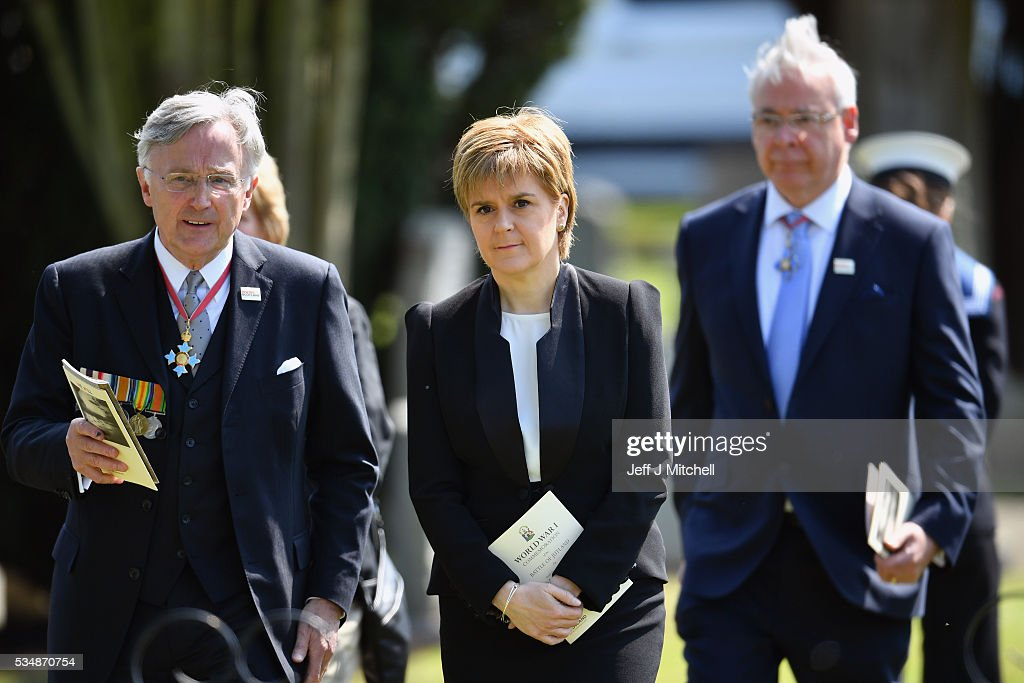 First Minister <a gi-track='captionPersonalityLinkClicked' href=/galleries/search?phrase=Nicola+Sturgeon&family=editorial&specificpeople=2582617 ng-click='$event.stopPropagation()'>Nicola Sturgeon</a> (C) attends a service at a war graves cemetery to mark the Battle of Jutland on May 28, 2016 in South Queensferry,Scotland. The events begin a weekend of commemoration leading up to the anniversary on 31 May and 1 June to mark the centenary of the largest naval battle of World War One where more than 6,000 Britons and 2,500 Germans died in the Battle of Jutland.