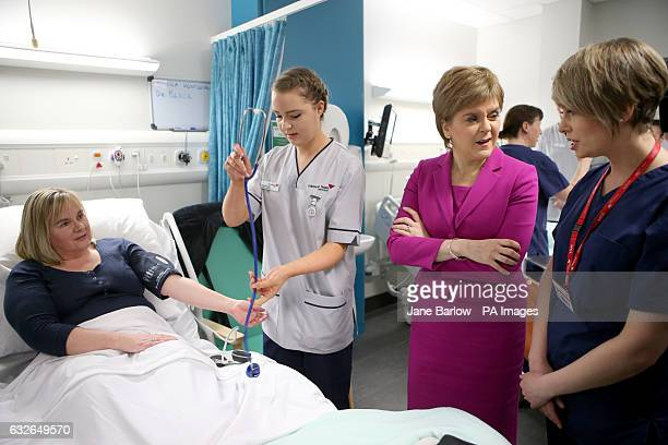 First Minister Nicola Sturgeon meets midwifery lecturer Shona Montgomery playing the role of a patient for student nurses in a ward situation during...