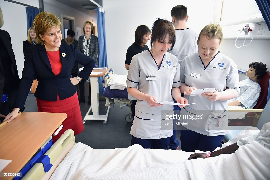 First Minister <a gi-track='captionPersonalityLinkClicked' href=/galleries/search?phrase=Nicola+Sturgeon&family=editorial&specificpeople=2582617 ng-click='$event.stopPropagation()'>Nicola Sturgeon</a> meets with students on a mock hospital ward at Queen Margaret University on February 10, 2016 in Mussleburgh, Scotland. The First Minister set out her vision for the future of health and care services in Scotland during a speech to students at the university.