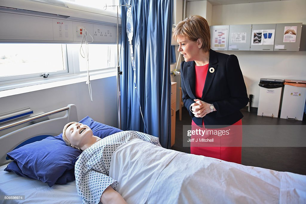 First Minister <a gi-track='captionPersonalityLinkClicked' href=/galleries/search?phrase=Nicola+Sturgeon&family=editorial&specificpeople=2582617 ng-click='$event.stopPropagation()'>Nicola Sturgeon</a> observes a human training dummy as she meets with students at a mock hospital ward at Queen Margaret University on February 10, 2016 in Mussleburgh, Scotland. The First Minister set out her vision for the future of health and care services in Scotland during a speech to students at the university.