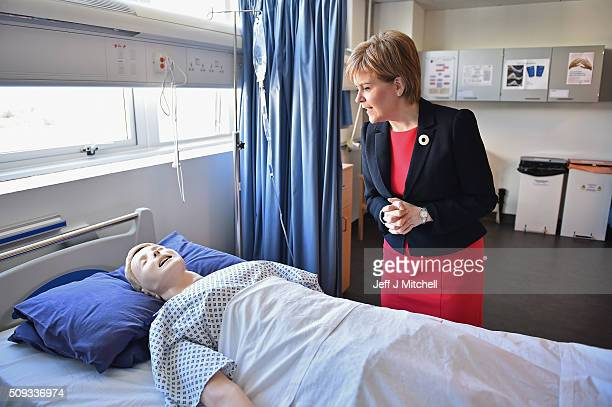 First Minister Nicola Sturgeon observes a human training dummy as she meets with students at a mock hospital ward at Queen Margaret University on...