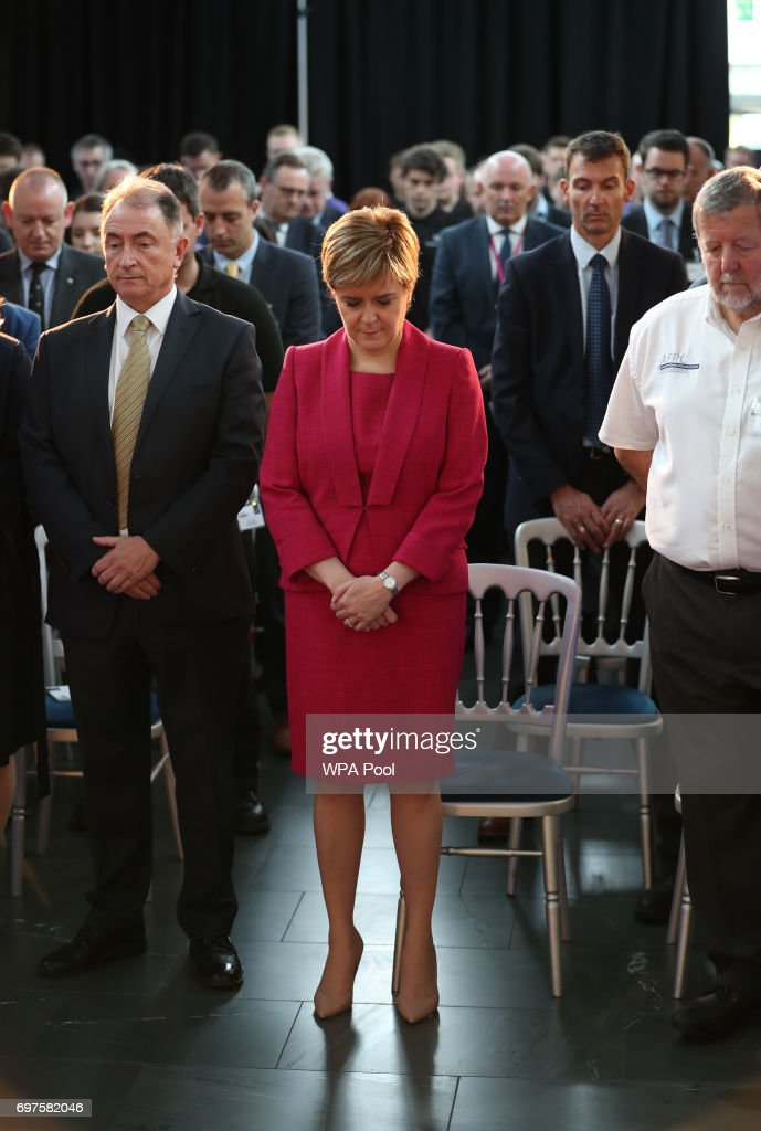 First Minister Nicola Sturgeon observes a minute's silence during a visit to the Advanced Forming Research Centre in Renfrew, Glasgow, in memory of those who died in the Grenfell Tower fire in west London last week. on June 19, 2017 in Renfrew, Scotland.