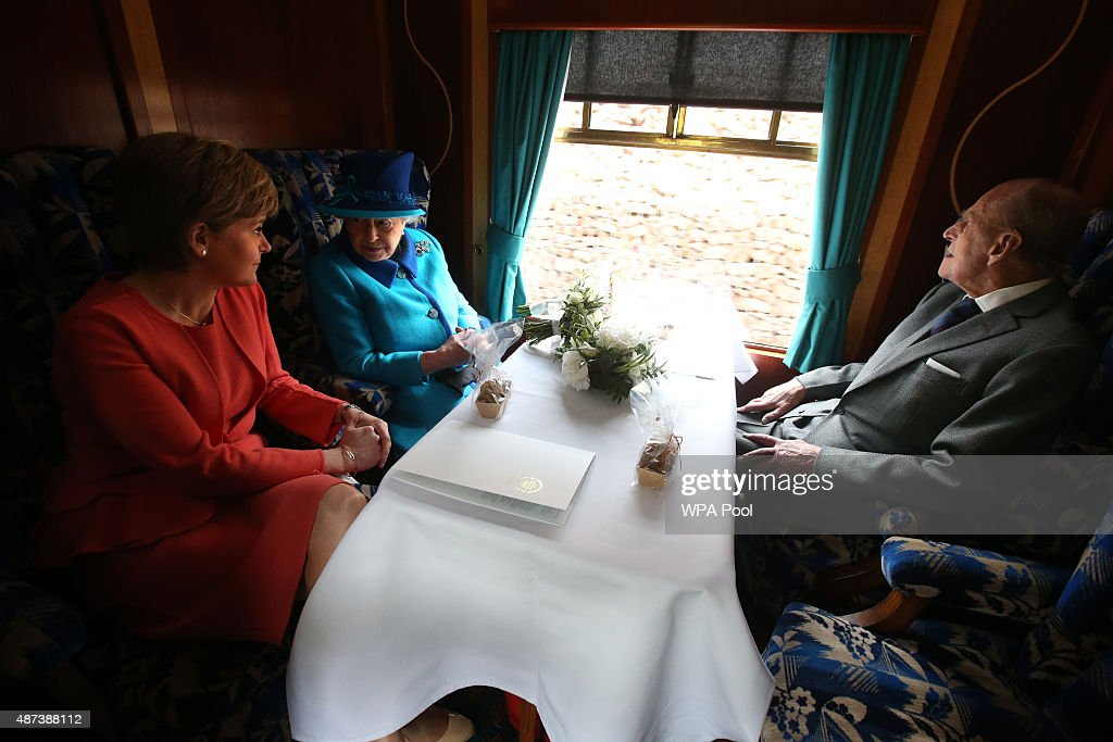 First Minister Nicola Sturgeon, Queen Elizabeth II and Prince Philip, Duke of Edinburgh, travel on a steam train to inaugurate the new £294 million Scottish Borders Railway, on the day the Queen becomes Britain's longest reigning monarch, on September 9, 2015 in Tweedbank, England.