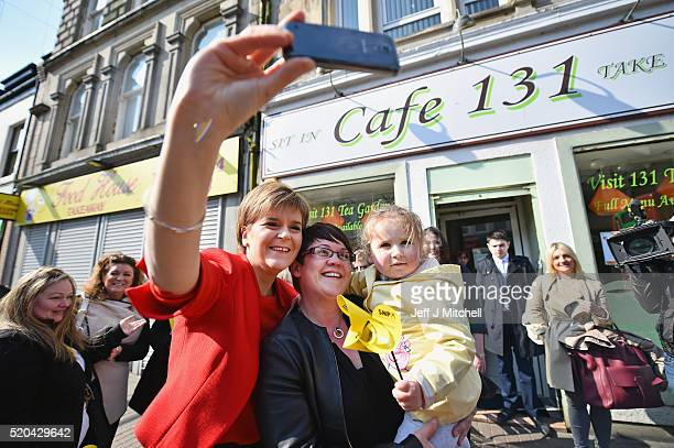 First Minister Nicola Sturgeon takes a selfie as she meets with locals as she set out the SNP's commitments to older people in Scotland during...