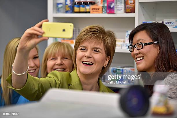 First Minister Nicola Sturgeon takes a selfie on the campaign trail on April 4 2015 in Edinburgh Scotland SNP Leader Nicola Sturgeon today set out...