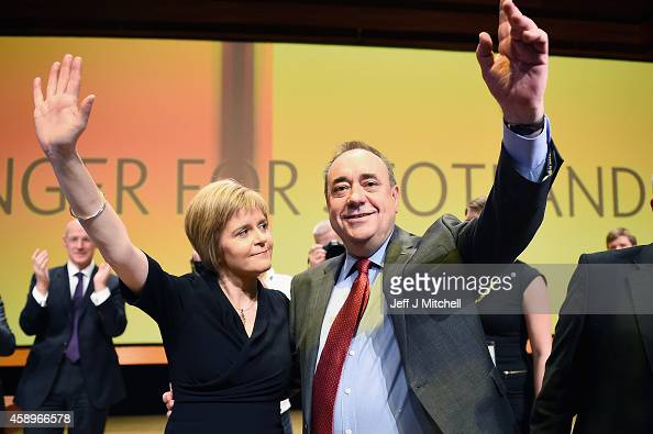 First Minister of Scotland Alex Salmond acknowledges applause with Nicola Sturgeon following his last key note speech as party leader of the SNP at...