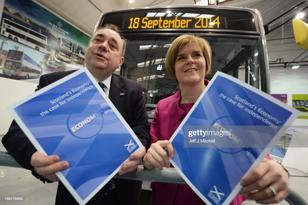 First Minister of Scotland <a gi-track='captionPersonalityLinkClicked' href=/galleries/search?phrase=Alex+Salmond&family=editorial&specificpeople=857688 ng-click='$event.stopPropagation()'>Alex Salmond</a> and Deputy First Minister <a gi-track='captionPersonalityLinkClicked' href=/galleries/search?phrase=Nicola+Sturgeon&family=editorial&specificpeople=2582617 ng-click='$event.stopPropagation()'>Nicola Sturgeon</a> launch a paper outlining the nation's economic strengths on May 21, 2013 in Falkirk, Scotland. The document, launched at Alexander Denis coach builders by the First Minister and Deputy First Minister <a gi-track='captionPersonalityLinkClicked' href=/galleries/search?phrase=Nicola+Sturgeon&family=editorial&specificpeople=2582617 ng-click='$event.stopPropagation()'>Nicola Sturgeon</a>, outlines a picture of the country's strong financial foundations, which would help ensure a prosperous nation with independence.
