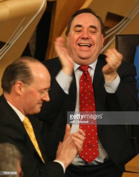 First Minister of Scotland Alex Salmond and Finance Minister John Swinney react after the budget debate at the Scottish Parliament on February 6 2008...