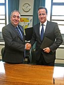 First Minister of Scotland Alex Salmond shakes hands with Prime Minister David Cameron after signing a referendum agreement at St Andrew's House in...