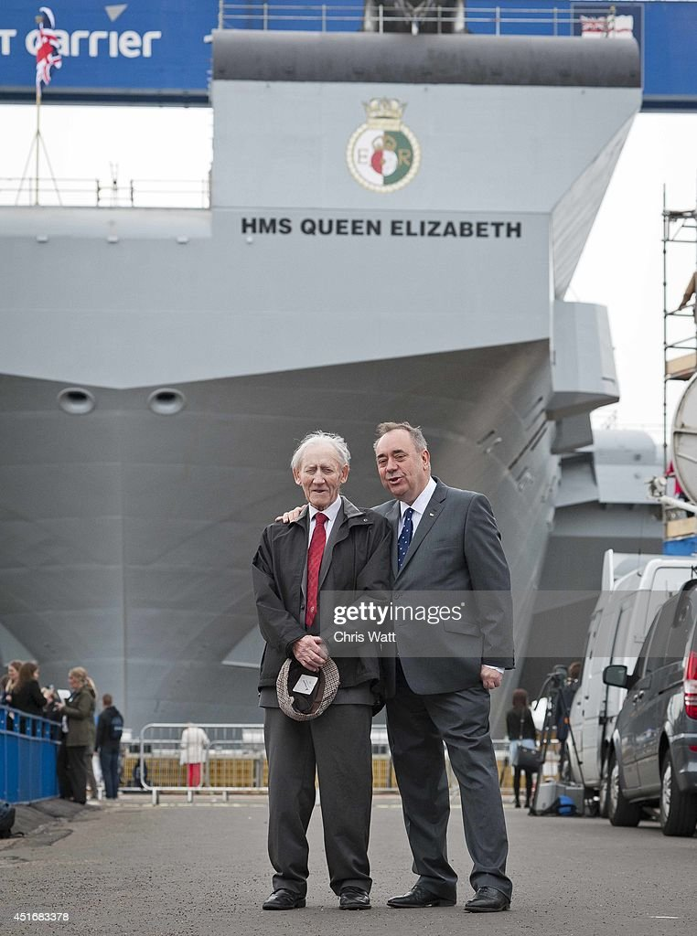 First Minister of Scotland Alex Salmond with his father Robert after the Queen Elizabeth II officially named the Royal Navy's new aircraft carrier HMS Queen Elizabeth on July 4, 2014 in Rosyth, Scotland. HMS Queen Elizabeth is the largest warship ever built in the UK weighing 65,000-tonnes, six shipyards around the UK have been involved in building various parts of the carrier. The ship is capable of carrying up to forty aircraft, is scheduled to be launched later this summer, and to commission in early 2017, with full operational capability from 2020.