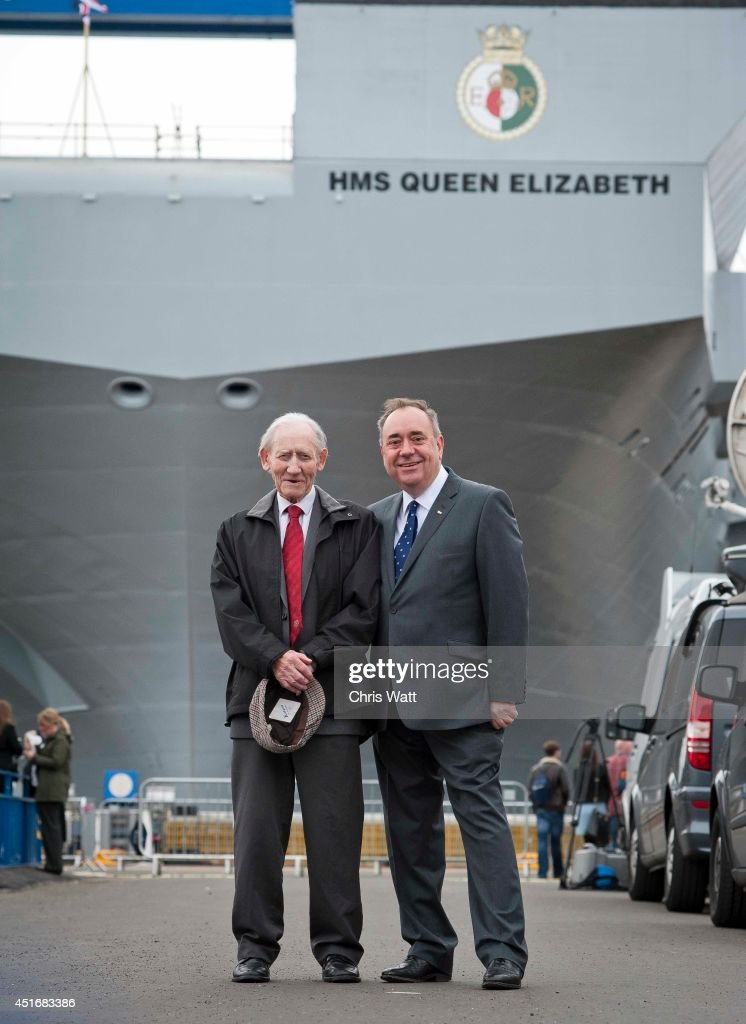 First Minister of Scotland <a gi-track='captionPersonalityLinkClicked' href=/galleries/search?phrase=Alex+Salmond&family=editorial&specificpeople=857688 ng-click='$event.stopPropagation()'>Alex Salmond</a> with his father Robert after the Queen Elizabeth II officially named the Royal Navy's new aircraft carrier HMS Queen Elizabeth July 4, 2014 in Rosyth, Scotland.HMS Queen Elizabeth is the largest warship ever built in the UK weighing 65,000-tonnes, six shipyards around the UK have been involved in building various parts of the carrier. The ship is capable of carrying up to forty aircraft, is scheduled to be launched later this summer, and to commission in early 2017, with full operational capability from 2020.