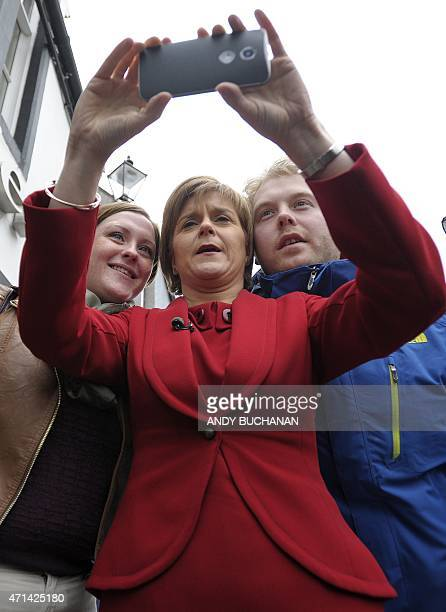 First Minister of Scotland and leader of the Scottish National Party Nicola Sturgeon poses for a selfie as she campaigns in South Queensferry on the...