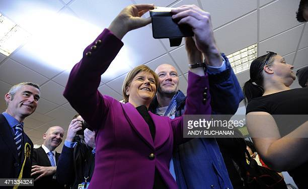 First Minister of Scotland and leader of the SNP Nicola Sturgeon poses with a supporter for a selfie photograph during a UK general election campaign...