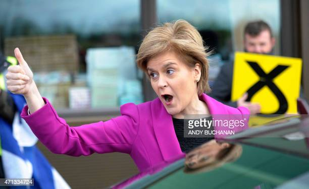 First Minister of Scotland and leader of the SNP Nicola Sturgeon gives a thumbsup as she leaves the Cook School in Kilmarnock Ayrshire southwest...