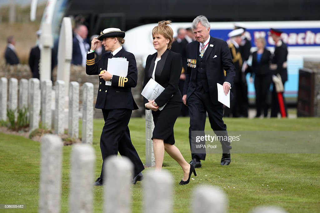 First Minister of Scotland <a gi-track='captionPersonalityLinkClicked' href=/galleries/search?phrase=Nicola+Sturgeon&family=editorial&specificpeople=2582617 ng-click='$event.stopPropagation()'>Nicola Sturgeon</a> (C) attends a service at Lyness Cemetery during the 100th anniversary commemorations for the Battle of Jutland on May 31, 2016 in Hoy, Scotland. The event marks the centenary of the largest naval battle of World War One where more than 6,000 Britons and 2,500 Germans died in the Battle of Jutland fought near the coast of Denmark on 31 May and 1 June 1916.