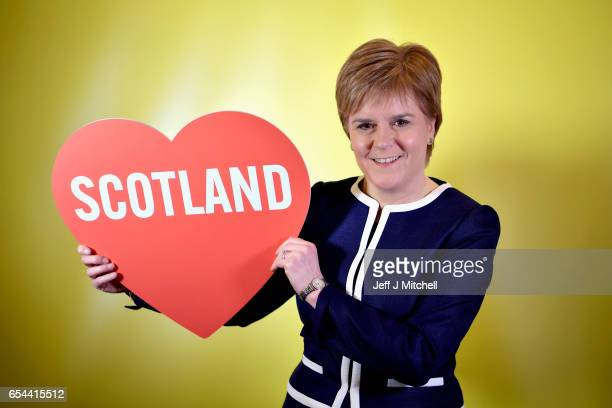 First Minister of Scotland Nicola Sturgeon poses for a photograph with a love heart at the spring conference on March 17 2017 in Aberdeen Scotland...