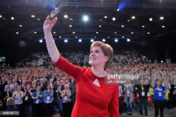 First Minister of Scotland Nicola Sturgeon takes a selfie on stage following her keynote speech at the 81st annual SNP conference at the Aberdeen...