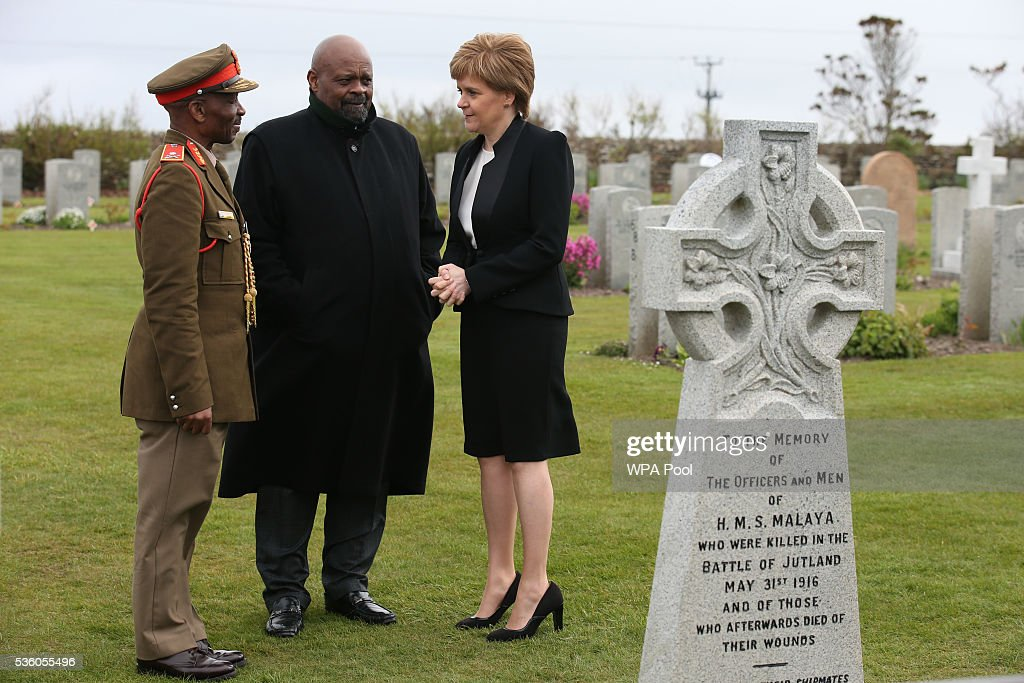 First Minister of Scotland Nicola Sturgeon with Obed Mlaba (C), South Africa's High Commissioner to the UK, and Brigadier General Mahlobo (L) talk after attending a service at Lyness Cemetery during the 100th anniversary commemorations for the Battle of Jutland on May 31, 2016 in Hoy, Scotland. The event marks the centenary of the largest naval battle of World War One where more than 6,000 Britons and 2,500 Germans died in the Battle of Jutland fought near the coast of Denmark on 31 May and 1 June 1916.