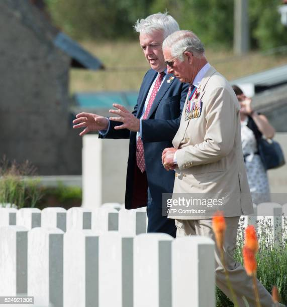 First Minister of Wales Carwyn Jones and Britain's Prince Charles talk during a ceremony at the Artillery Wood Cemetery in Ypres on July 31 as part...