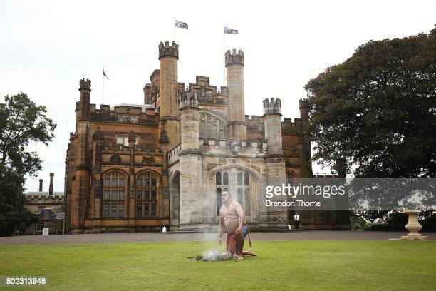 First Nation men dressed in traditional attire perform a smoking ceremony at Government House on June 28 2017 in Sydney Australia The flags will fly...