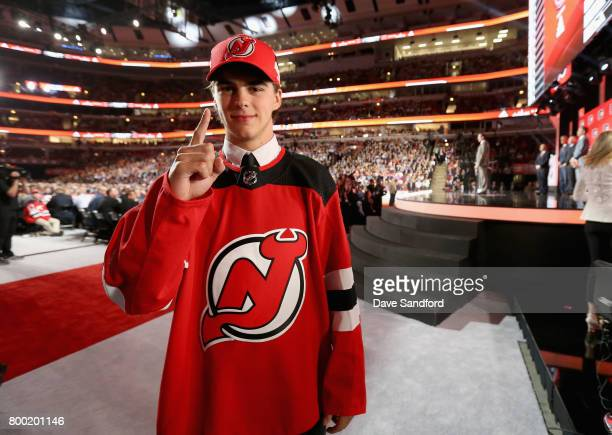 First overall draft pick Nico Hischier of New Jersey Devils poses during Round One of the 2017 NHL Draft at United Center on June 23 2017 in Chicago...
