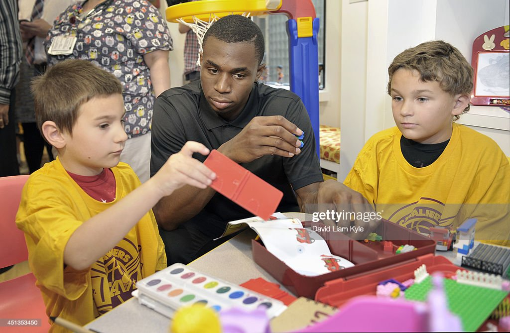 First overall pick Andrew Wiggins of the Cleveland Cavaliers plays along with young fans as the Cleveland Cavaliers unveiled the newly refurbished Activity Center at Cleveland Clinic Children's on June 27, 2014 in Cleveland, Ohio.